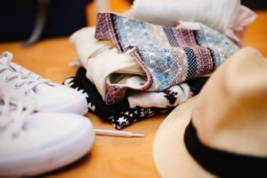 What is the average cost of clothes per month?